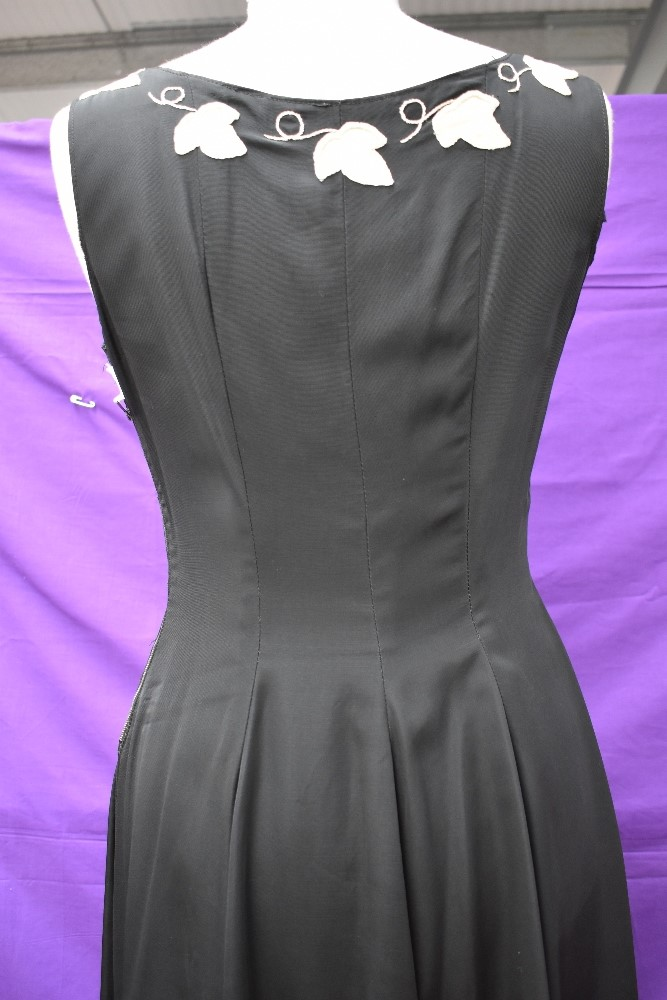 A vintage 1950s evening gown in black having cream ivy appliqué pattern and side metal zipper, - Image 6 of 8