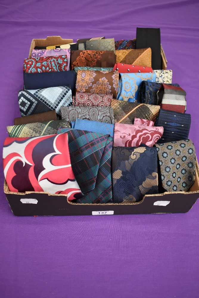 A box full of vintage gents ties, various styles and eras.