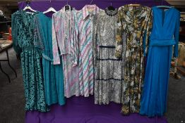 An assortment of vintage and retro Ladies clothing in a variety of colours,styles and eras including