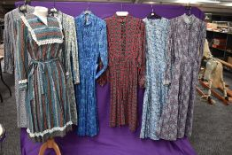 A selection of vintage and retro Ladies dresses in a variety of fabrics, patterns and styles.