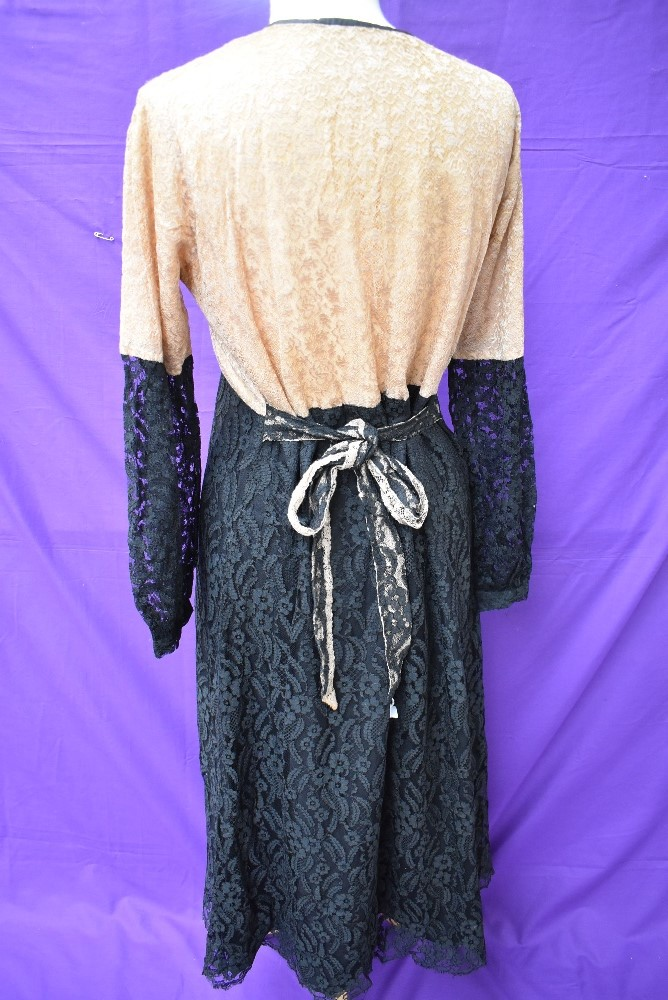 A 1930s black and taupe lace dress having silk lining and belted waist. - Image 4 of 4