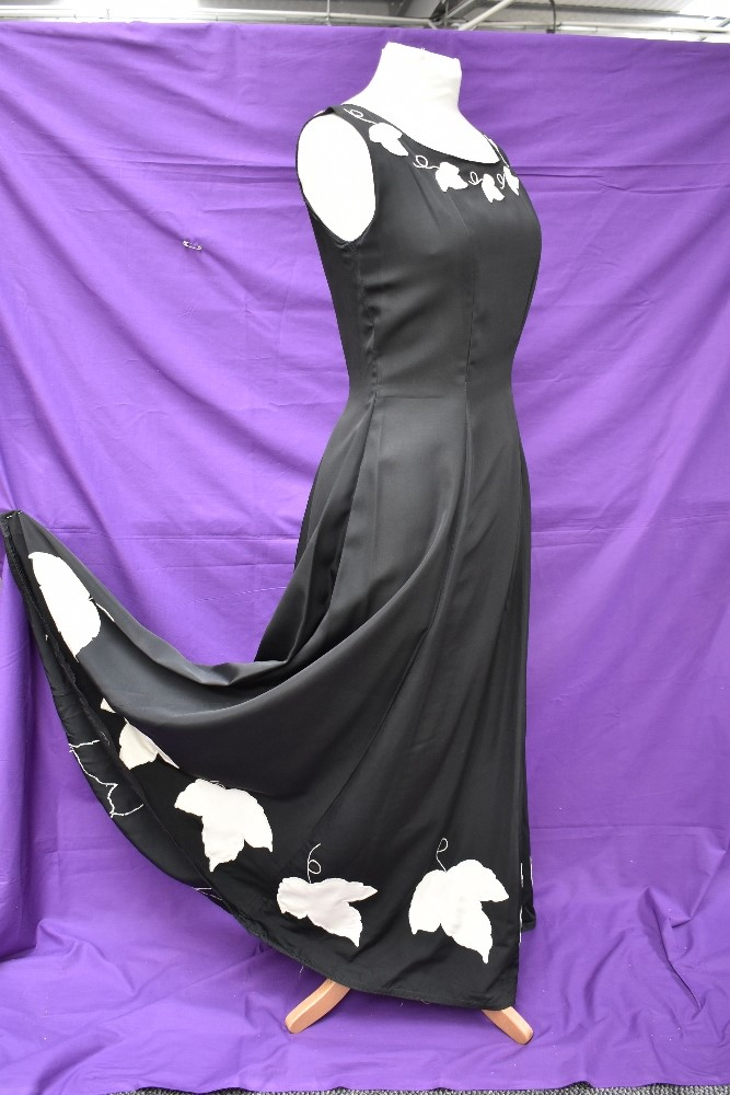 A vintage 1950s evening gown in black having cream ivy appliqué pattern and side metal zipper, - Image 4 of 8