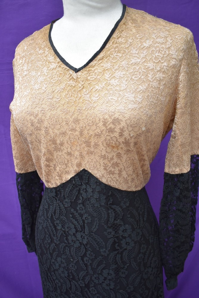 A 1930s black and taupe lace dress having silk lining and belted waist. - Image 3 of 4
