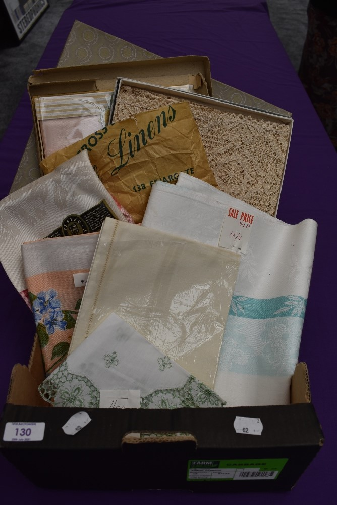 A collection of vintage table linen including Irish linen, all in boxes or with tags and packaging.