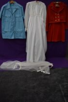 A mixture of ladies vintage clothing including wedding dress.