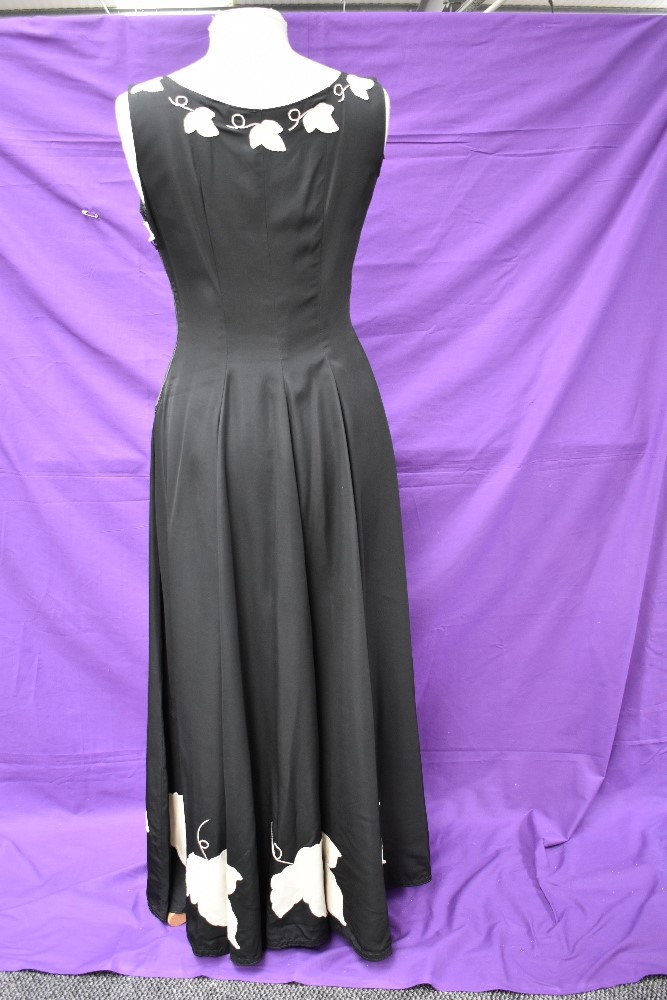 A vintage 1950s evening gown in black having cream ivy appliqué pattern and side metal zipper, - Image 5 of 8