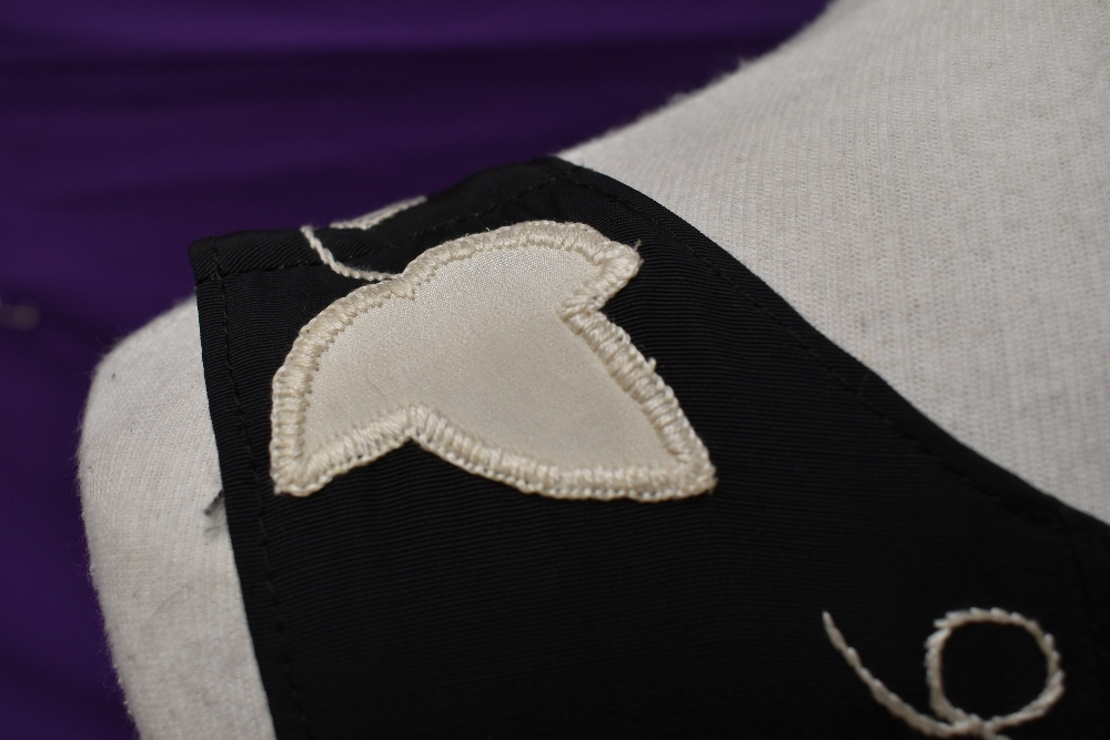 A vintage 1950s evening gown in black having cream ivy appliqué pattern and side metal zipper, - Image 7 of 8