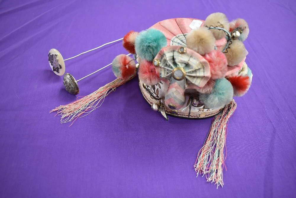 A vintage oriental cap with pom poms,bells, and metallic embroidery with mirrors, also included