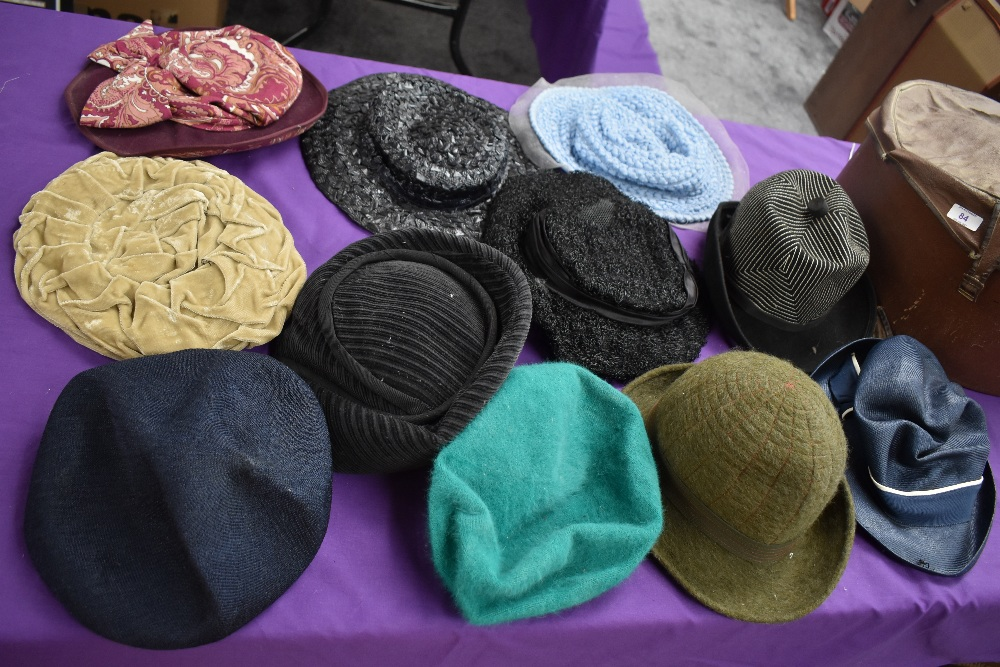 A hat case containing assorted vintage hats, 1940s to late 60s/early 70s.