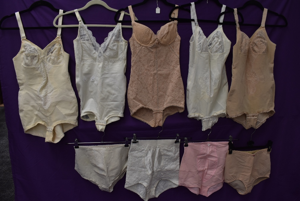 A collection of vintage corselettes and girdles.