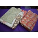 Two colourful antique patchwork quilts, both having damage.