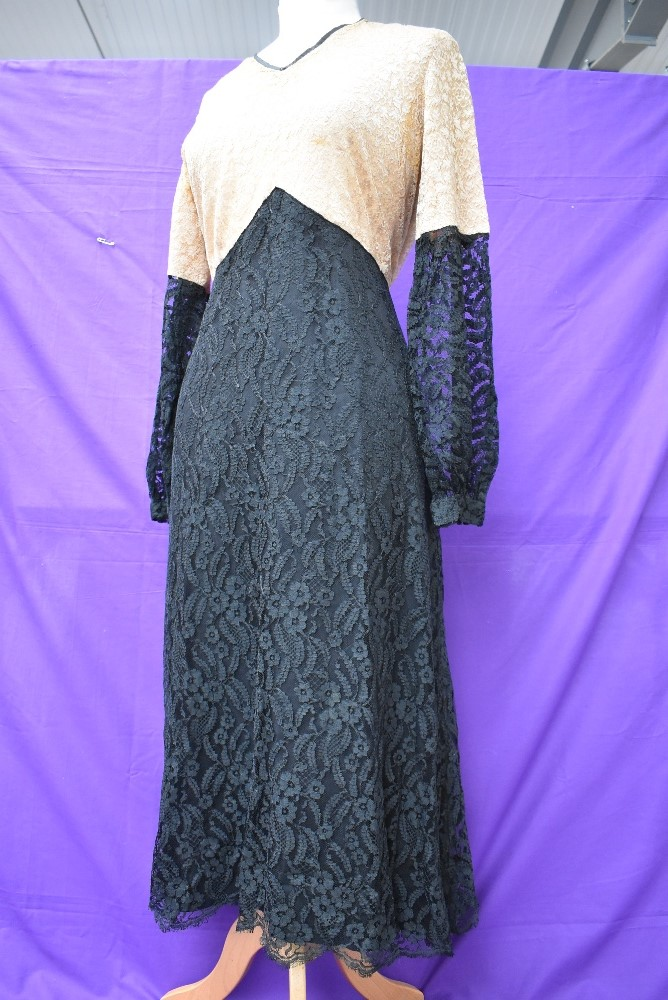 A 1930s black and taupe lace dress having silk lining and belted waist. - Image 2 of 4