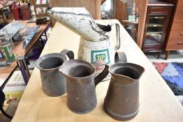 A collection of vintage oil jugs including BP.