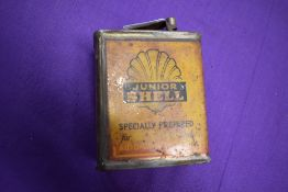 A vintage garage oil can for Shell Junior
