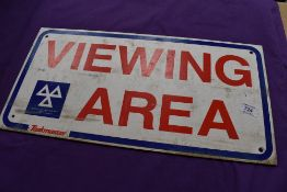 A vintage garage sign for Viewing Area Vehicle Testing Station