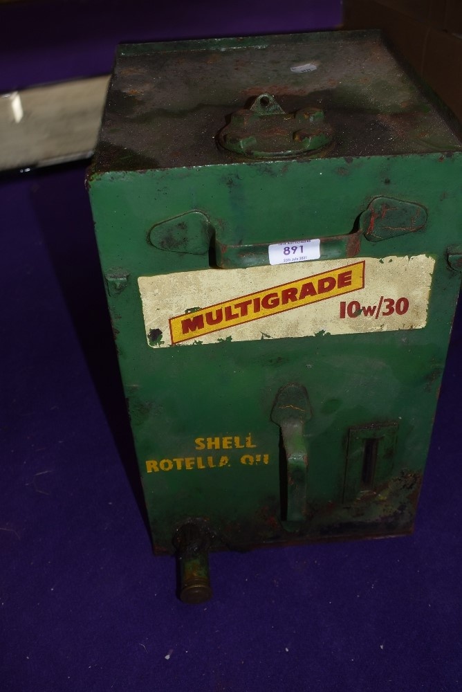 A large green garage oil or fuel can for Shell Rotella Oil