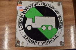 A small metal sign for London Boroughs Transport Scheme