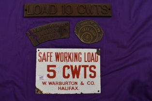 A selection of industrial crane badges including enamel cast iron and brass