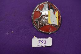 A vintage motor car engine hood badge for Bedford