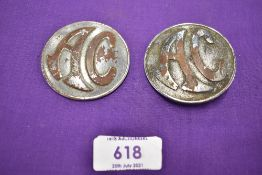 Two motor car engine badges for AC
