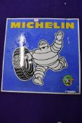A vintage garage sign for Michelin Tyres
