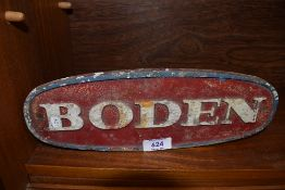A cast iron Boden truck or similar motor sign