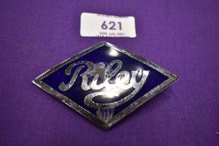 A Riley RM radiator badge