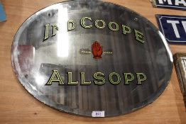 A vintage pub tavern advertising mirror for Ind Coope Allsopp brewery in original oval frame