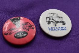 Landrover and Leyland lapel badges.