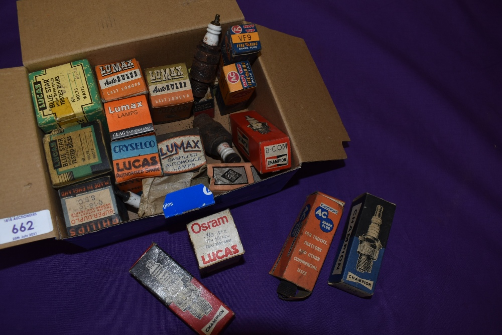 A collection of vintage spark plug and light bulb display boxes.