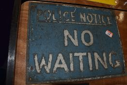 A vintage cast metal sign for No Waiting Police Notice