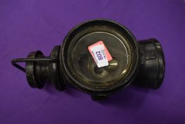 A genuine motor car nearside head lamp by P and H or Powell and Hammer