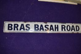 A vintage road side enamel sign reading Bras Basah Road