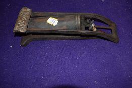 A vintage garage commercial foot pump