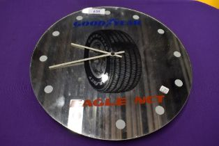 A garage advertising wall clock sign for Goodyear Tyres