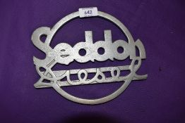 A reproduction cast metal commercial radiator badge for Seddon