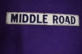 A vintage road side enamel sign reading Middle Road