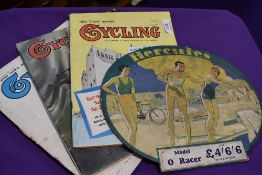 A selection of bicycle or cycling magazines and Hercules card sign