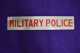 A vintage sign for the Military Police