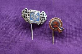 A BMC and a Leyland tie pin.