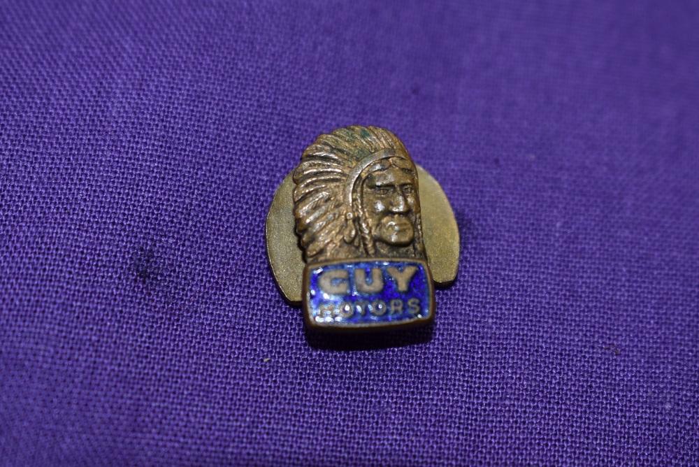 A Guy motors lapel badge.