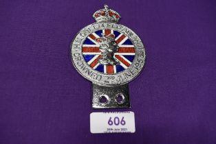A coronation motor car engine badge dated 1953