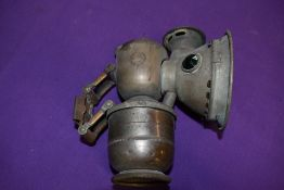 A vintage motor car or cycle carbide lamp by Lucas