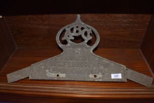 A cast metal sign for ABC Garage Astley Brook Huddersfield