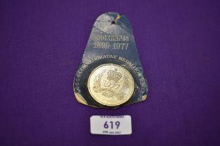 A Duckhams oild commemorative coin or medallion