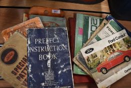 A selection of motoring ephemera and instruction manuals for Ford manuals