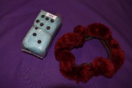 A vintage 1960s set of furry dice as new, and a steering wheel cover.