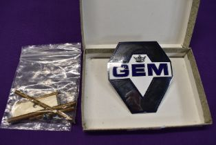 A motor car engine badge for GEM motoring assist