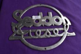 A large original Seddon diesel radiator badge.
