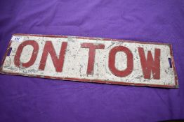 An 'ON TOW' plate